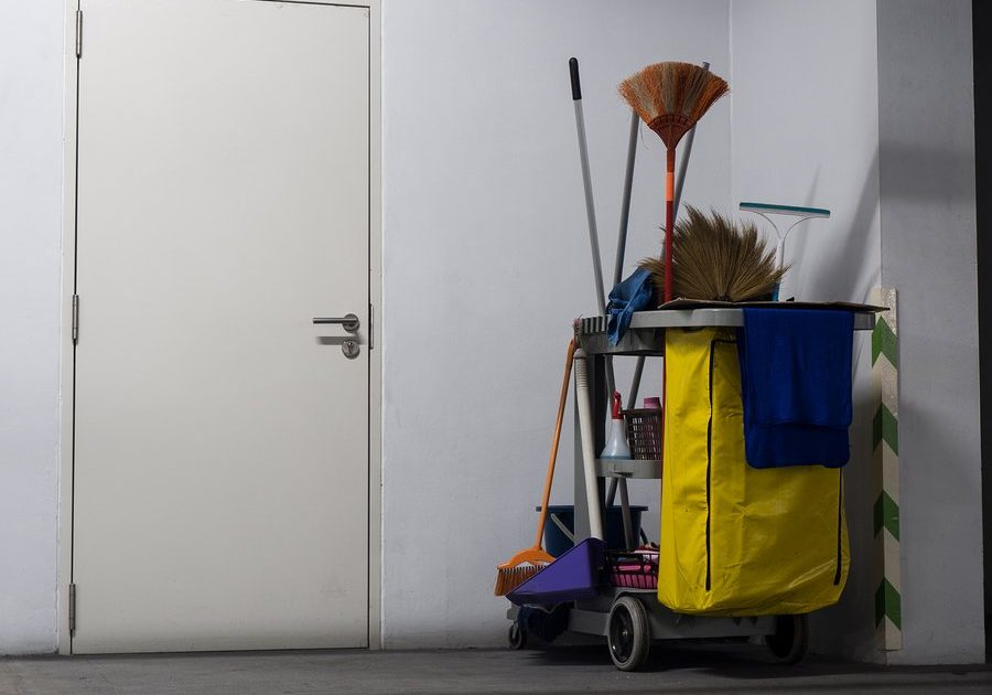 a trolley full of cleaning tools